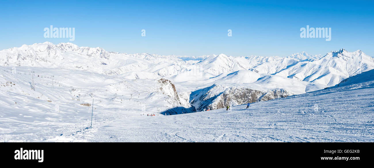 """People skiing in the ski resort called """"les Deux Alpes"""". We can see on the right the famous Mont Blanc. France, Stock Photo"""