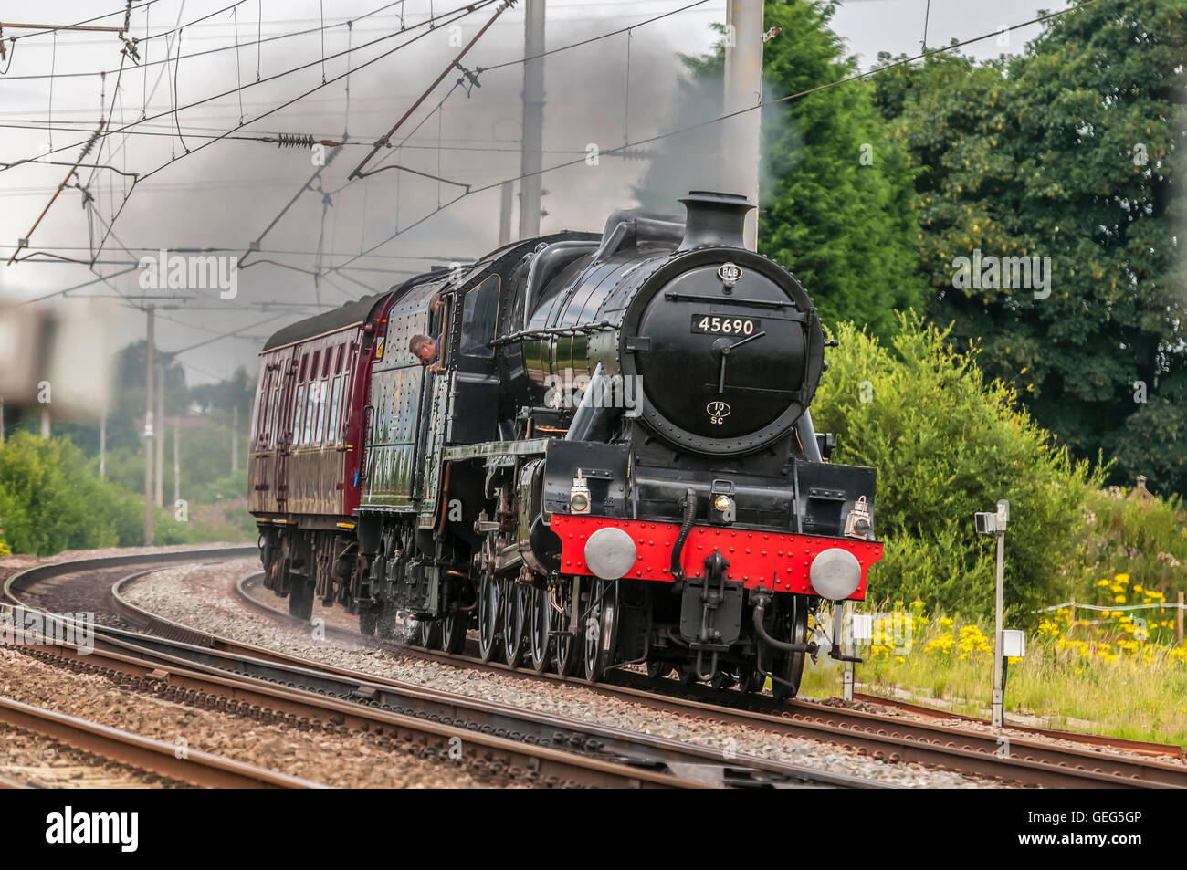 LMS Jubilee Class 6P 4-6-0 no 45690 Leander steam locomotive at speed passing Winwick junction on the West Coast - Stock Image