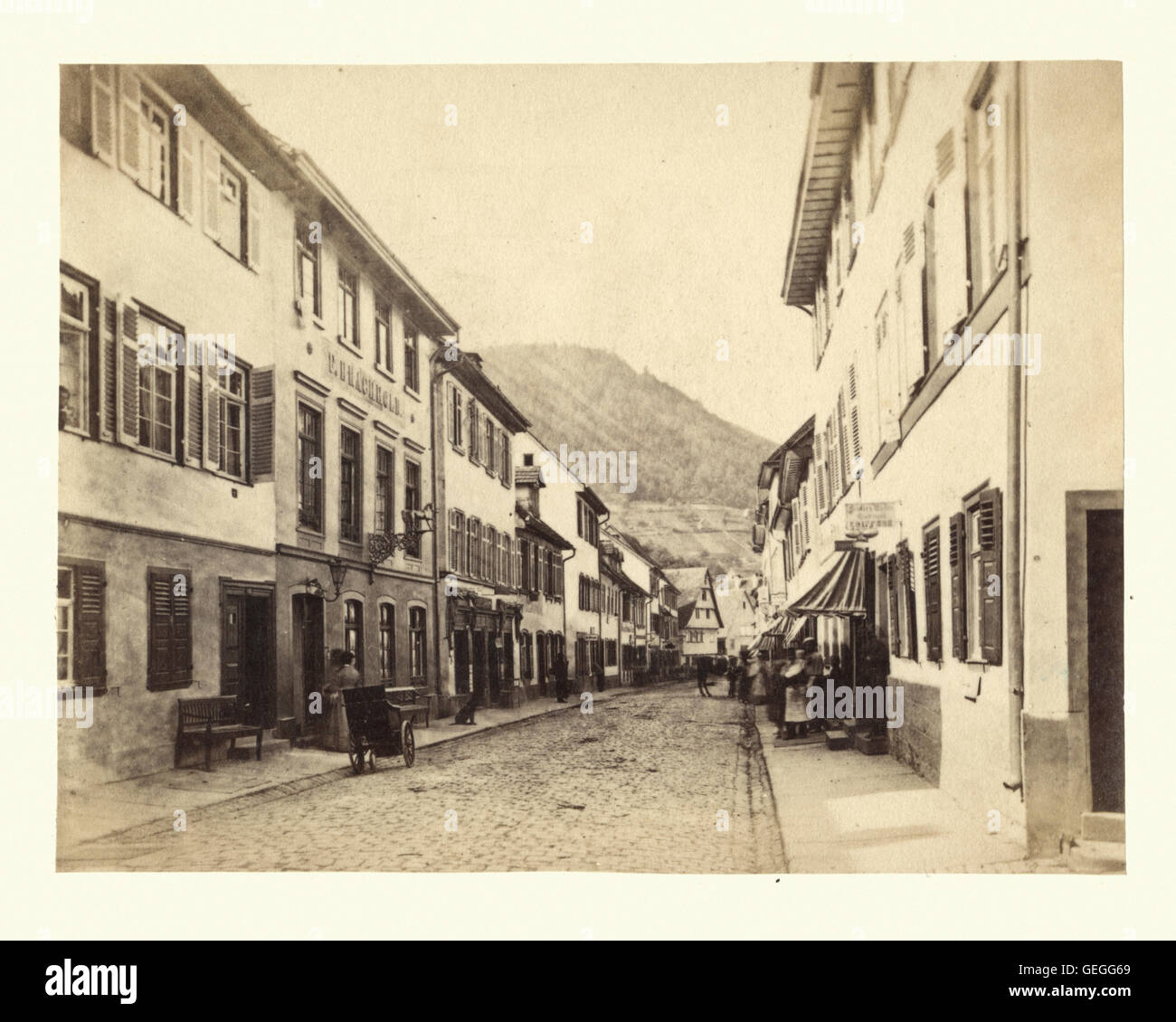 Antique photograph of a street view in Heidelberg, Baden-Wurttemberg, Germany, 19th Century. L Meder - Stock Image