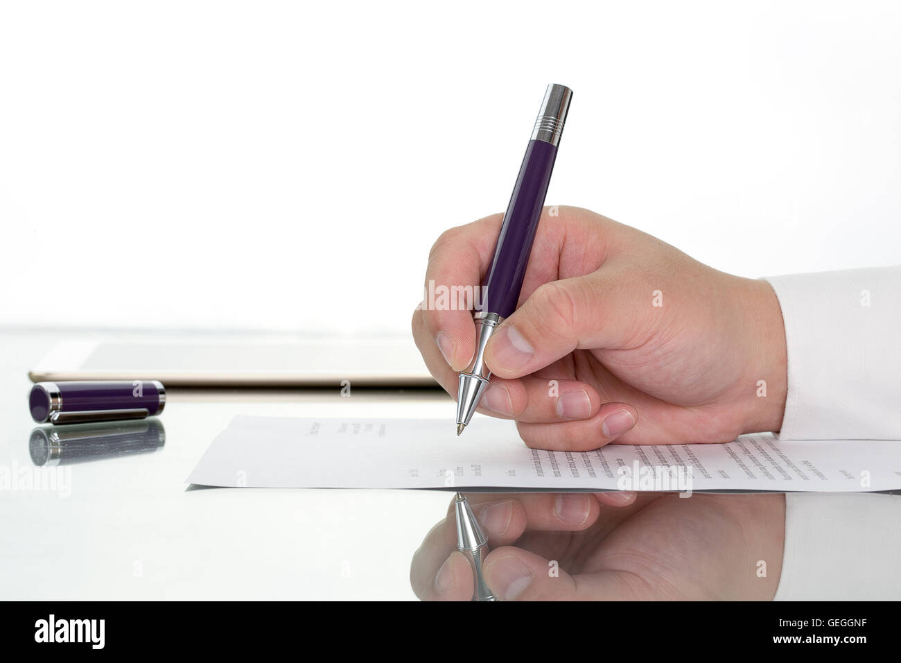 Hand with pen over application form, Businessman signing a contract with ballpoint concept. - Stock Image