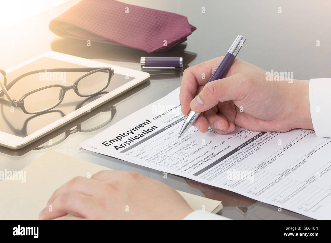 Businessman fill in Employment Application form with pen. job vacancy concept or business employment concept. Stock Photo