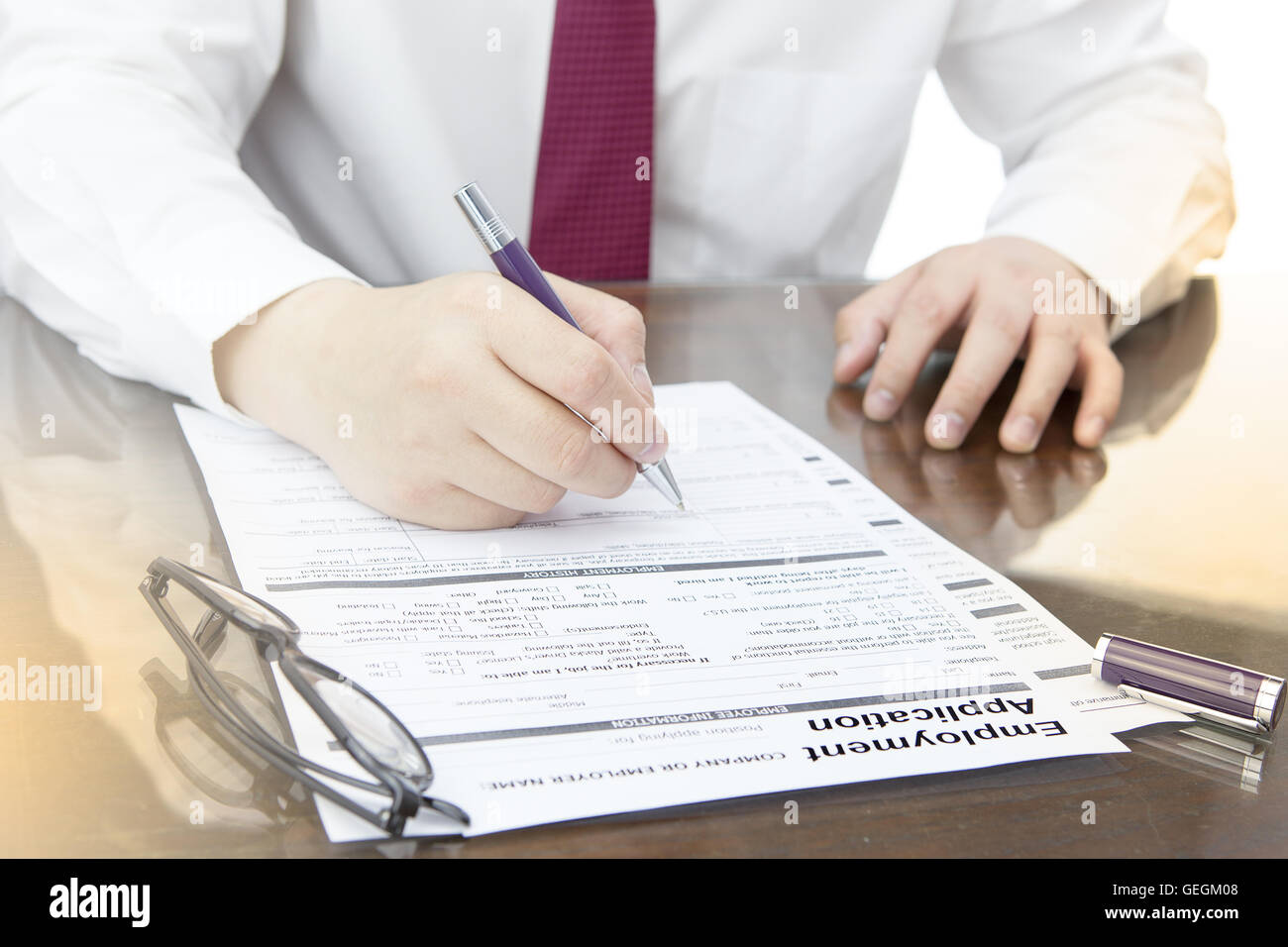 Businessman fill in Employment Application form with pen. job ...