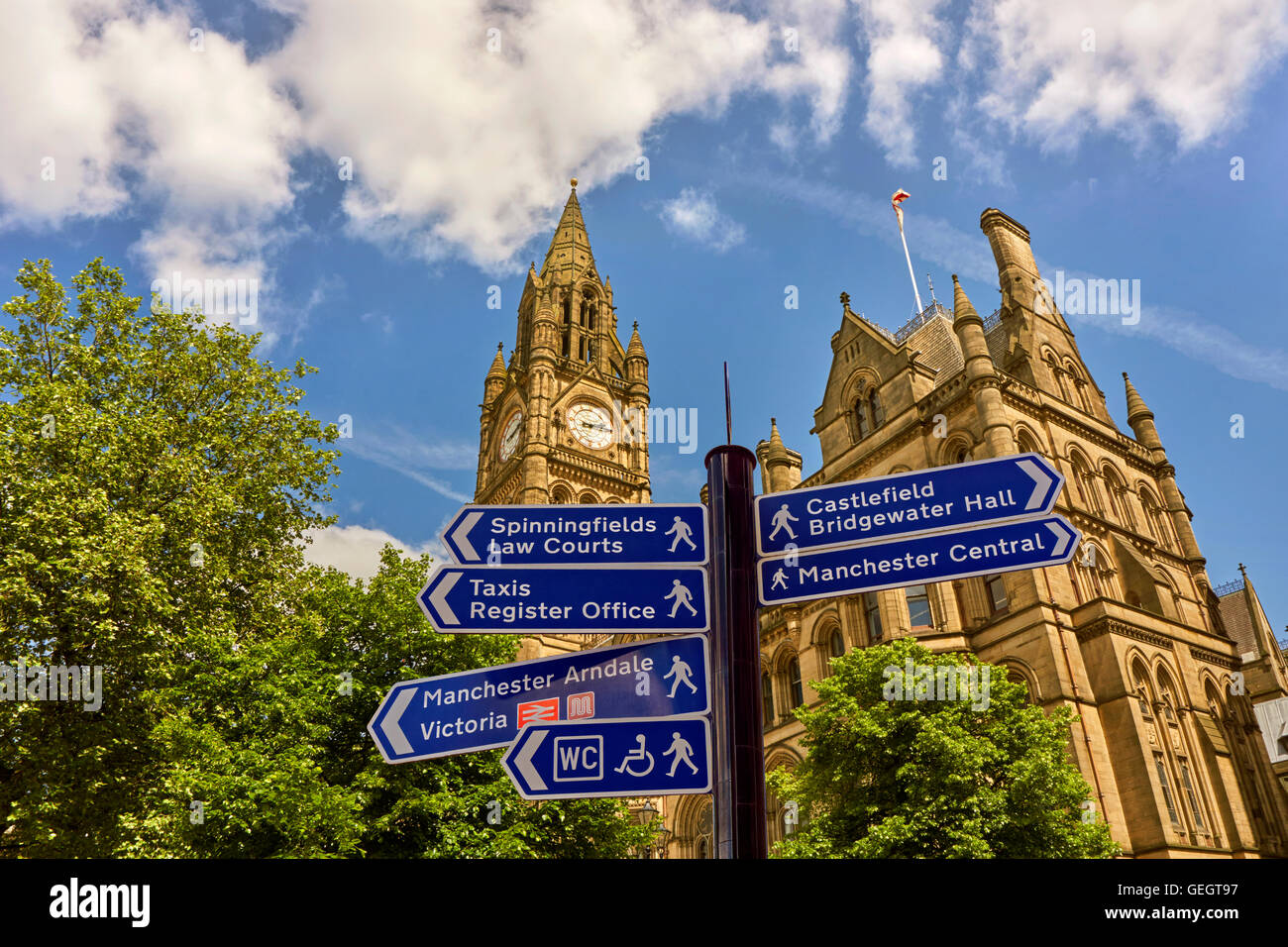 Tourist and citizen direction signs at Manchester Town Hall, corner of Albert Square and Mount Street, Manchester - Stock Image