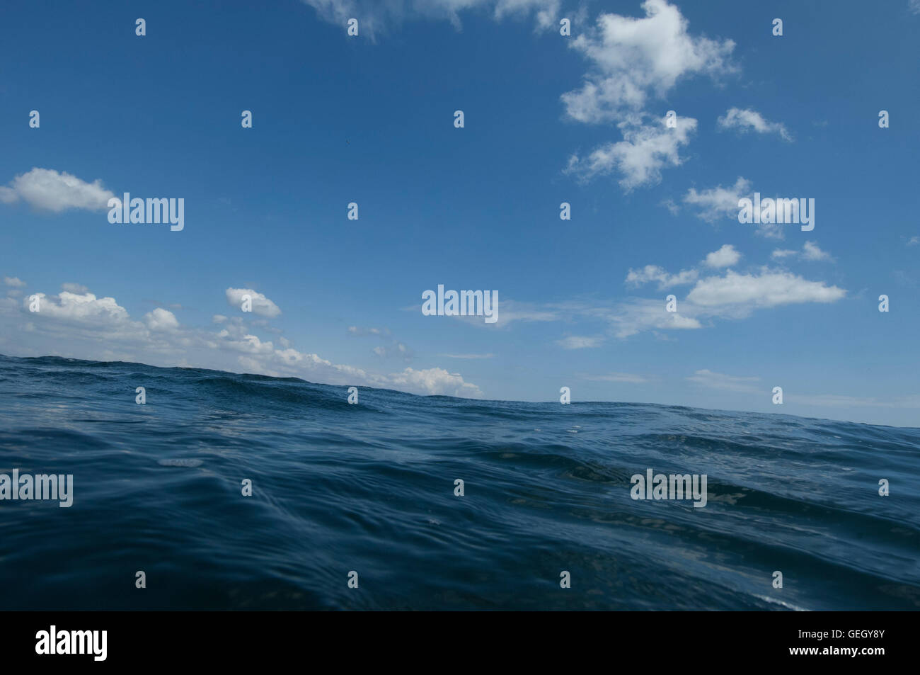 Point of view image for someone floating alone in the ocean. - Stock Image