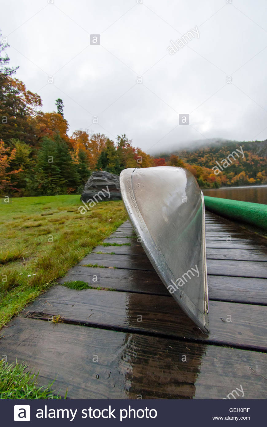 Bow of aluminum canoe on rainy day in New Hampshire - Stock Image