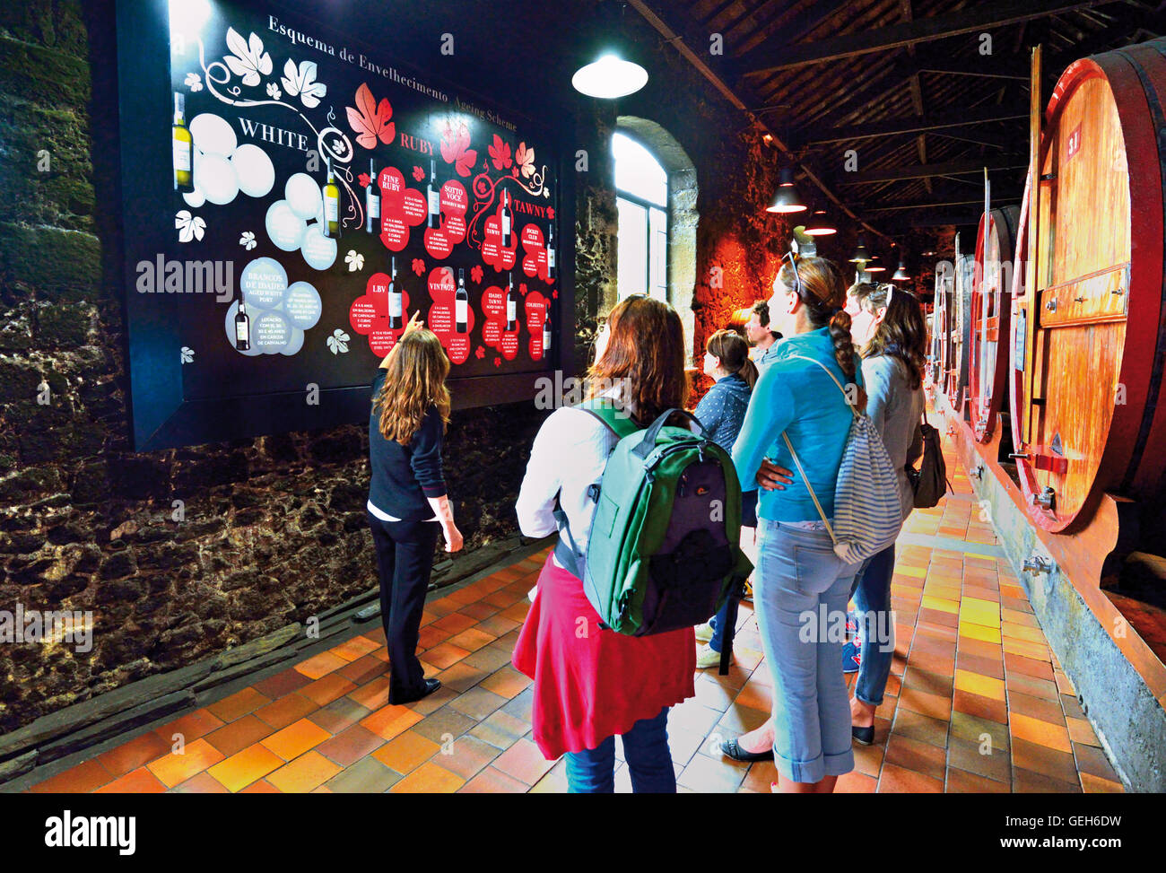Portugal, Oporto: Tourist group at guided tour about Port wine in the wine cellar Burmester - Stock Image