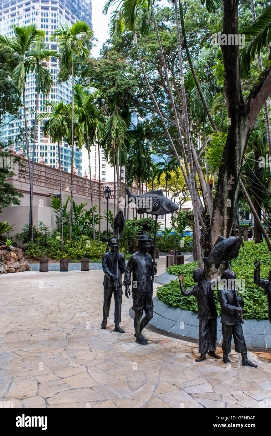 SINGAPORE - AUGUST 4, 2014: Chinese Procession sculpture atTelok Ayer Green Park in Singapore. Sculpture represents - Stock Image