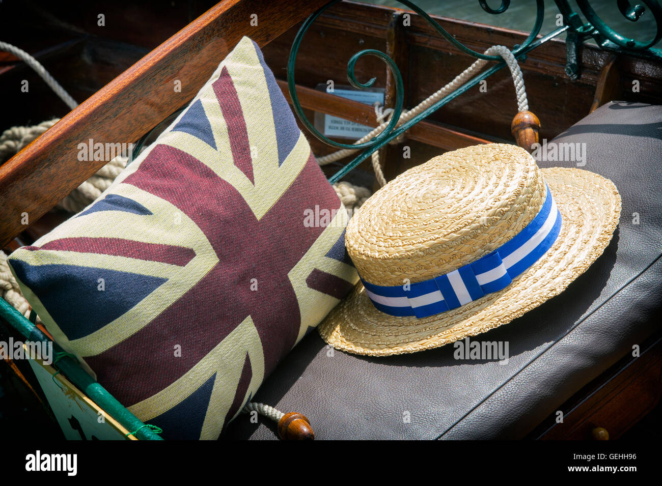 Boater and union jack cushion on a wooden rowing boat at the Thames Traditional Boat Festival, Henley On Thames, - Stock Image