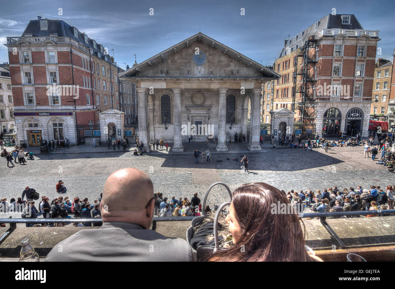 covent garden watching street entertainers - Stock Image