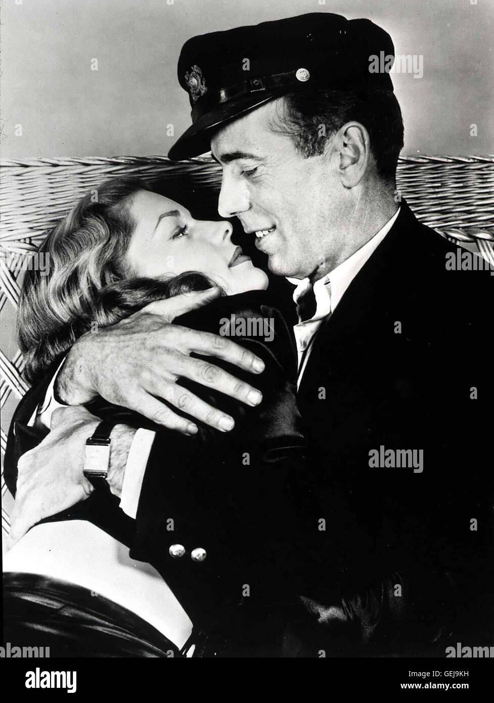 Lauren Bacall, Humphrey Bogart  Zwischen Morgan (Humphrey Bogart) und Marie (Lauren Bacall) entwickeln sich schon - Stock Image
