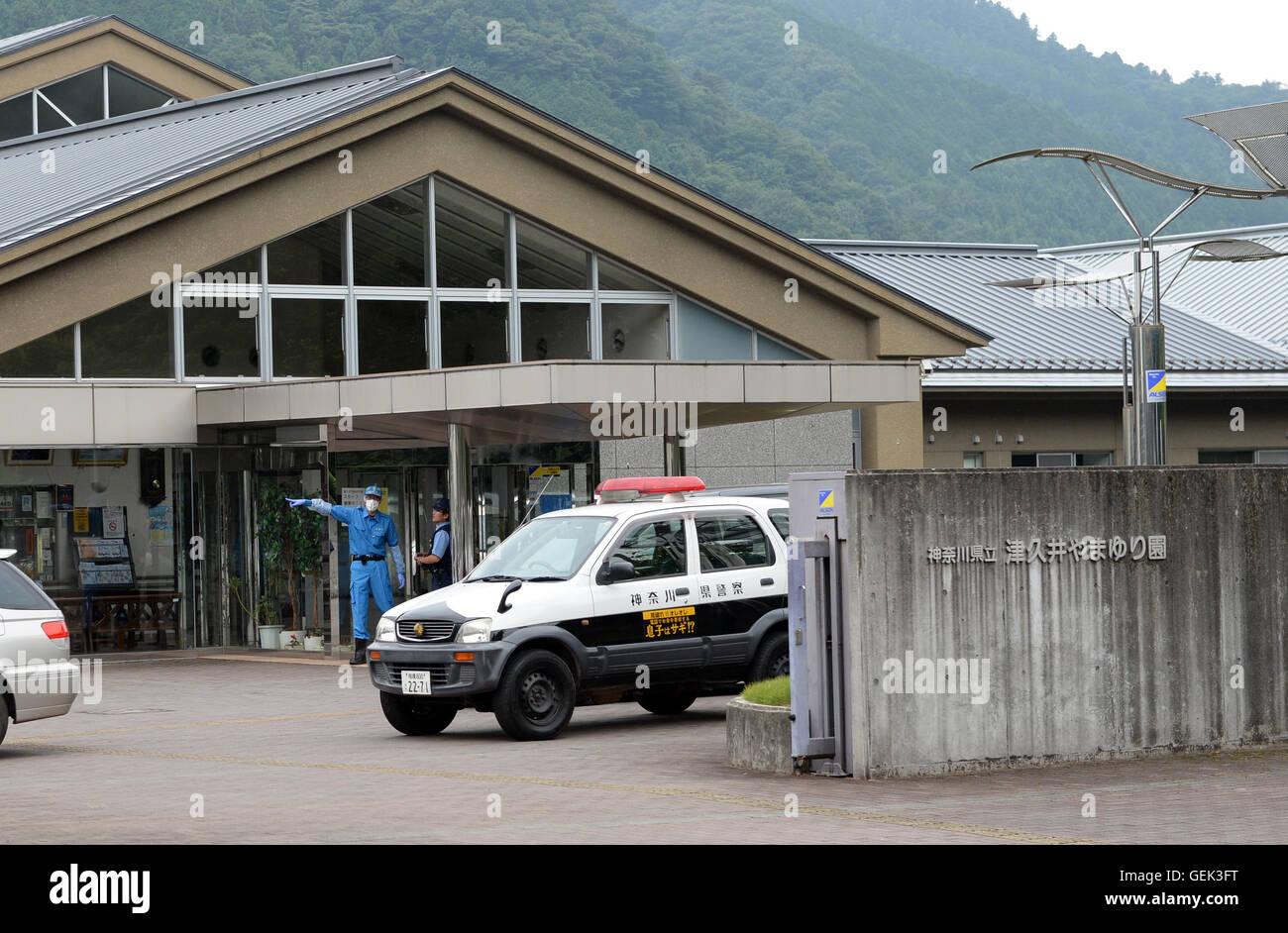 Sagamihara, Japan's Kanagawa Prefecture. 26th July, 2016. Police officers work outside of the Tsukui Yamayuri - Stock Image