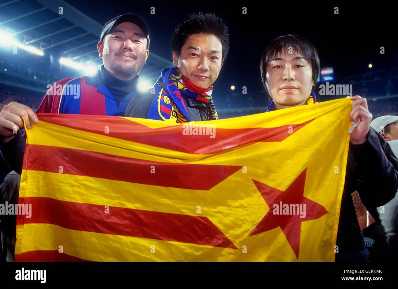 Fans of FC Barcelona with independence flag or senyera. In Camp Nou stadium. Barcelona,spain - Stock Image