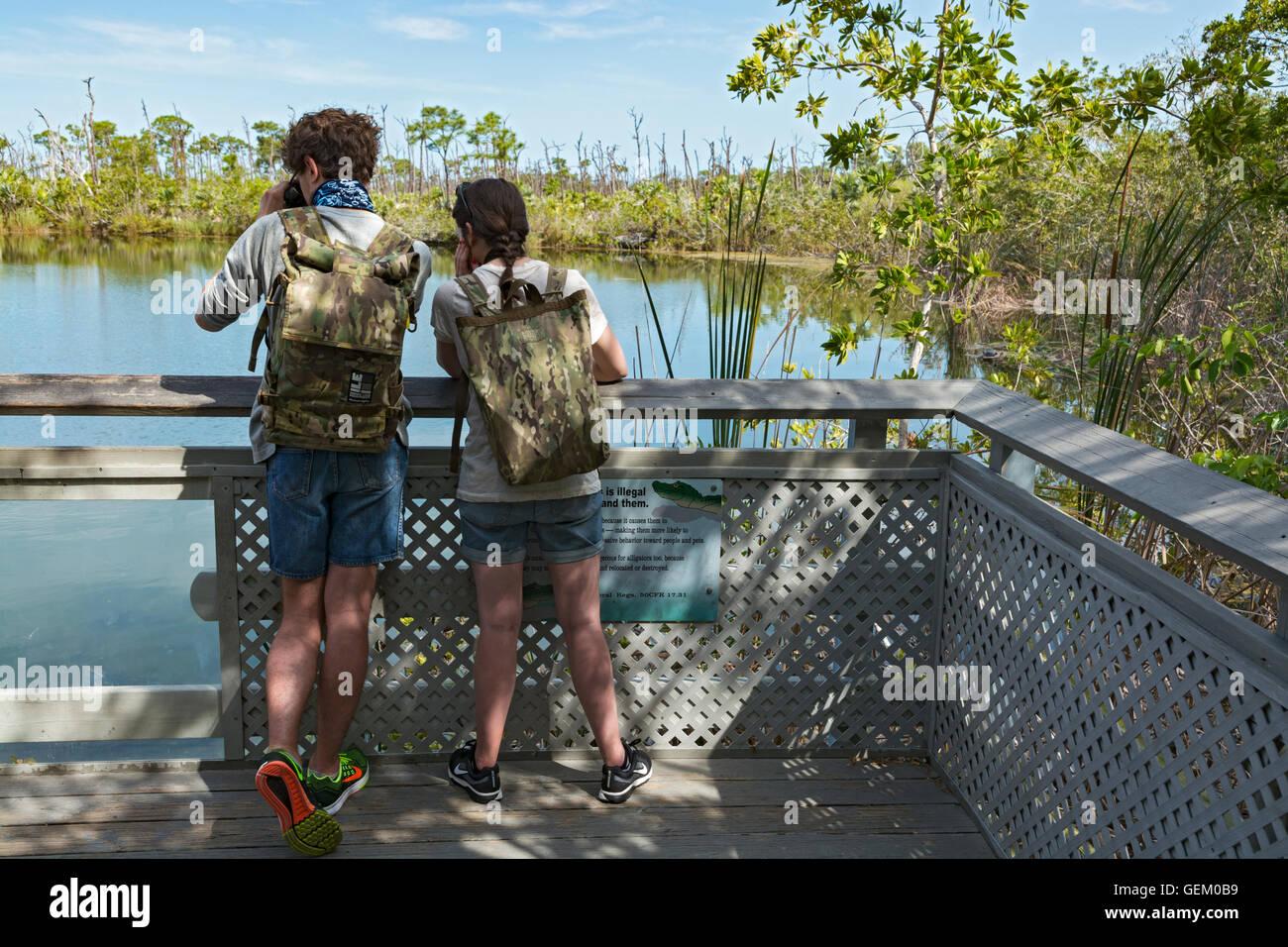 Florida, Big Pine Key, National Key Deer Refuge, The Blue Hole, abandoned limestone quarry, visiting couple - Stock Image