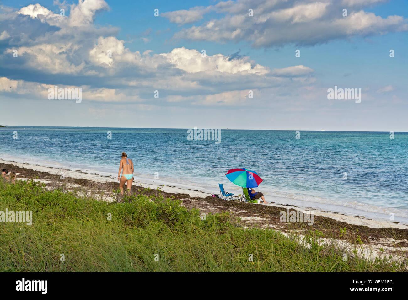 Florida Keys, Bahia Honda State Park, Seagrass on beach, umbrella, woman, bikini - Stock Image