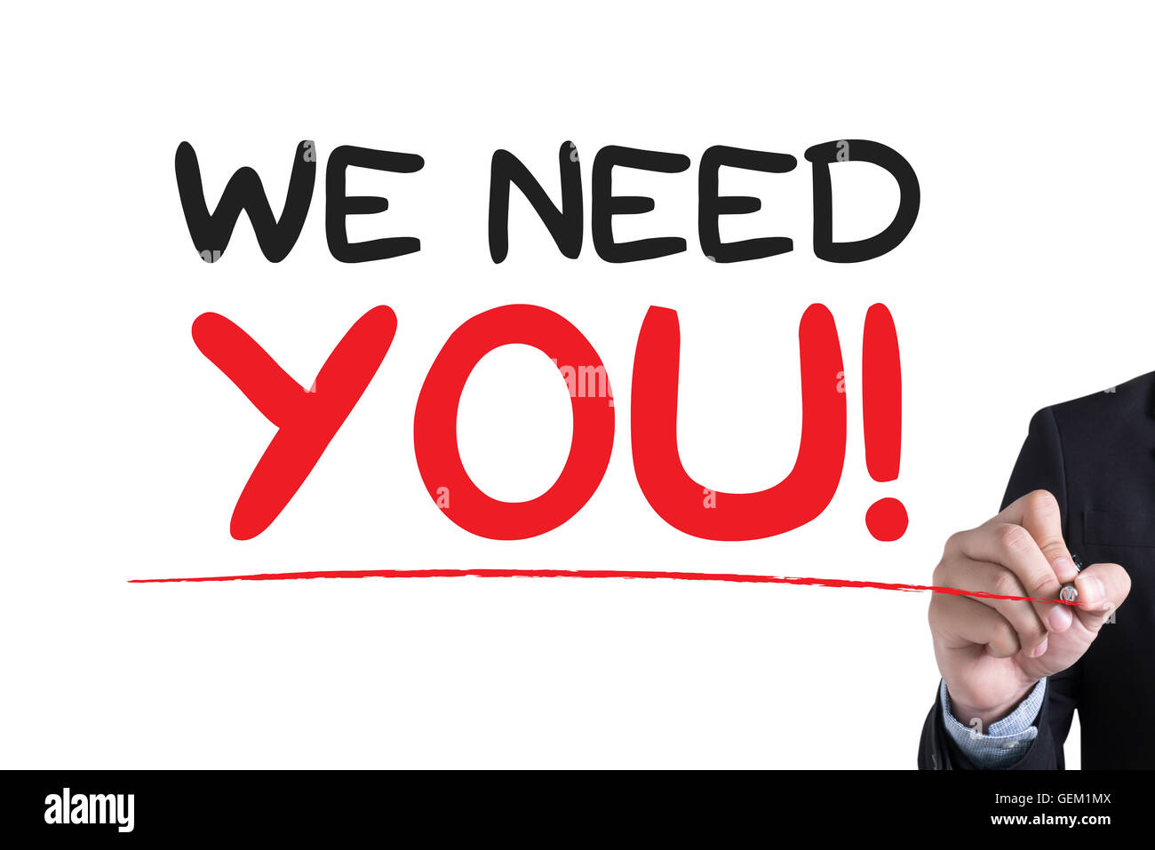 WE NEED YOU!  Businessman hand writing with black marker on white background - Stock Image