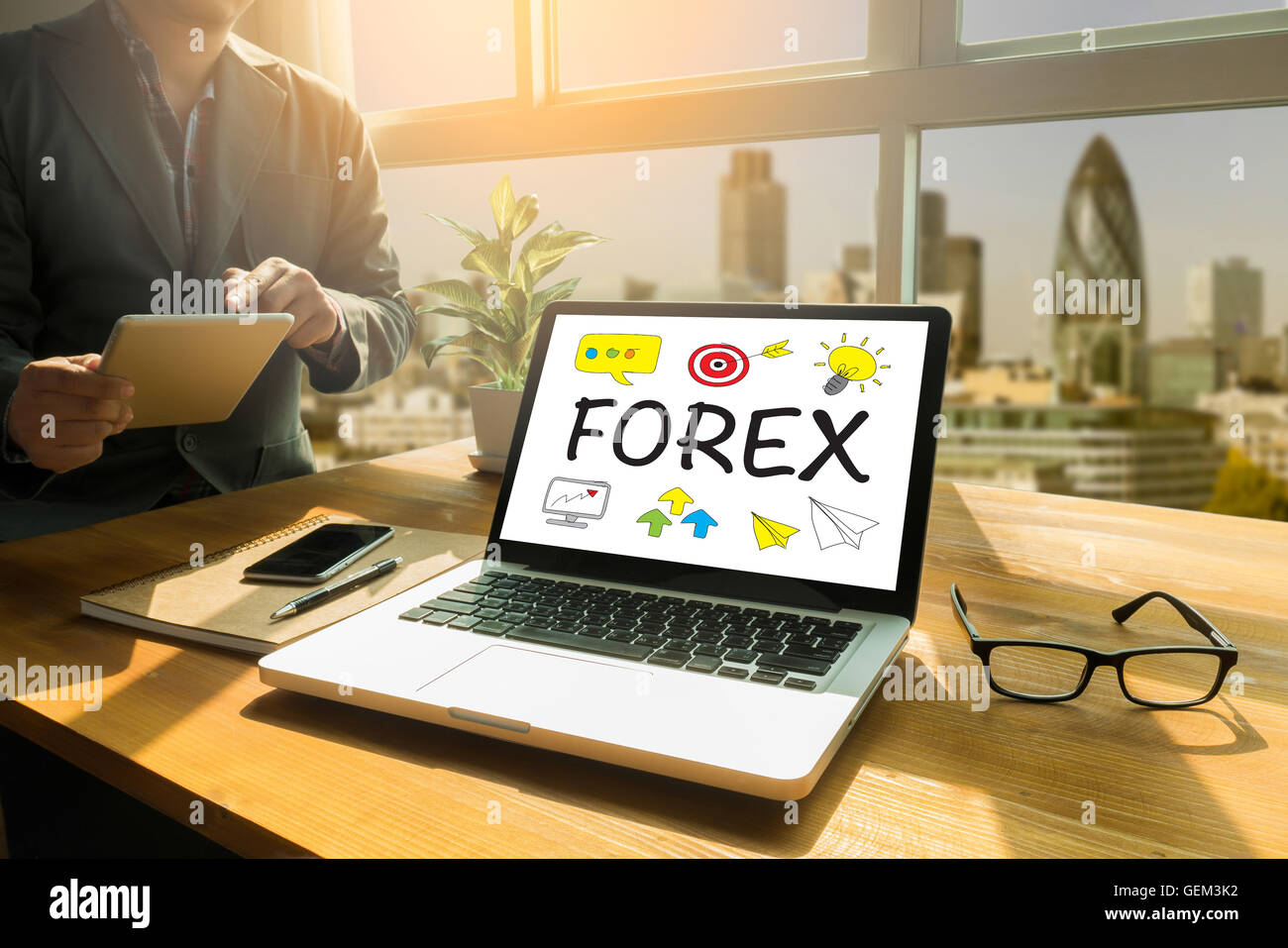 FOREX Thoughtful male person looking to the digital tablet screen, laptop screen,Silhouette and filter sun - Stock Image