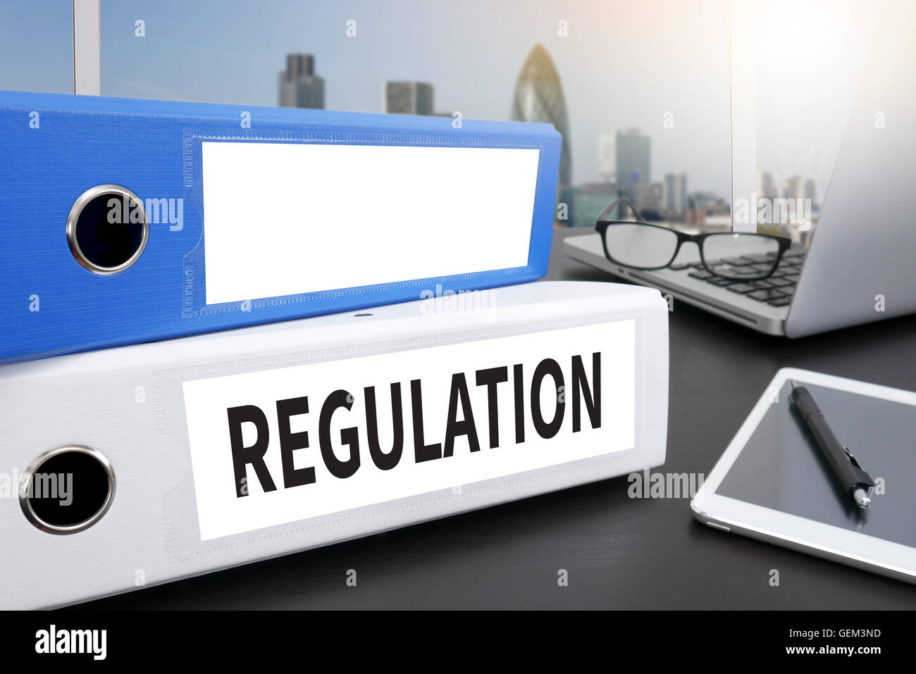 REGULATION Office folder on Desktop on table with Office Supplies. - Stock Image