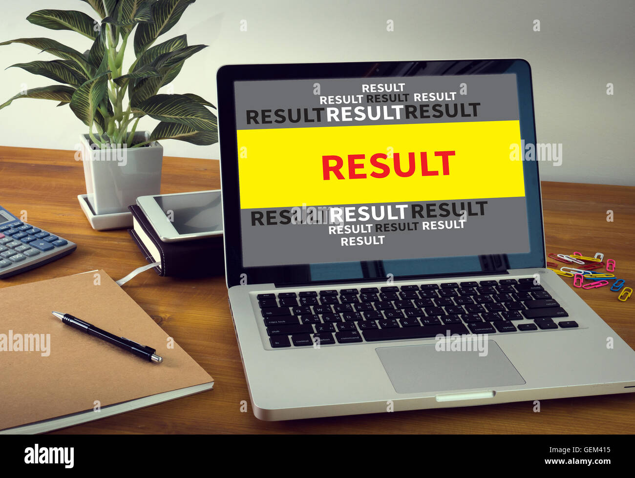 Laptop and RESULT Concept screen on table. Warm tone - Stock Image