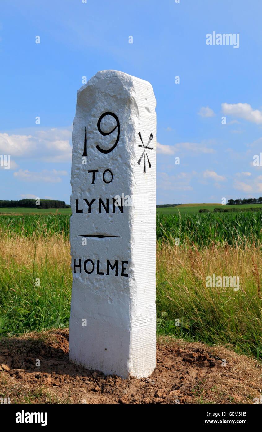 Old Milestone, Holme, Norfolk, 19 miles to Kings Lynn, broad arrow mark milestones marker markers roadside England - Stock Image