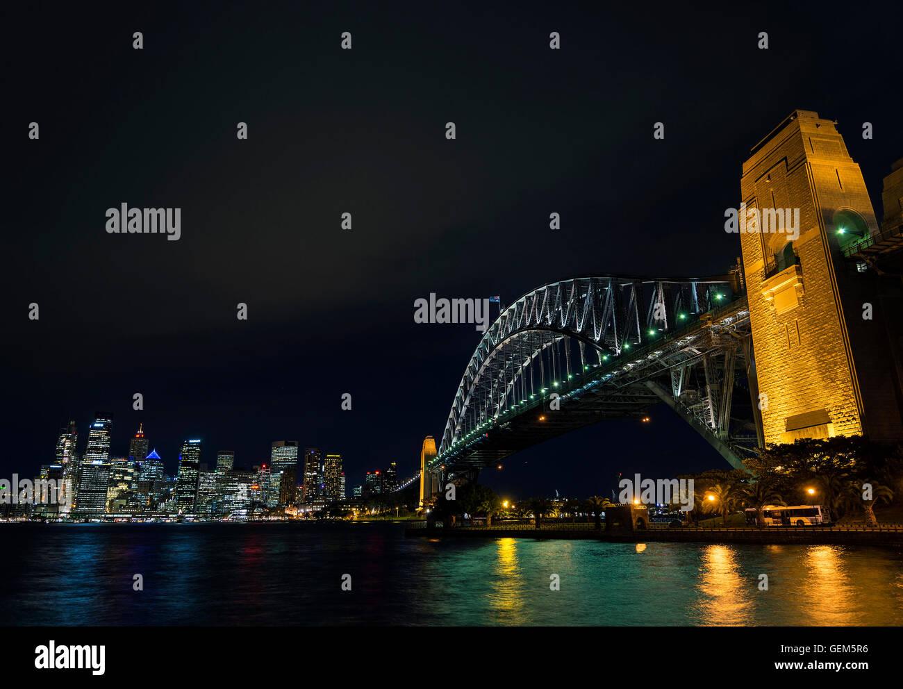 famous sydney harbour bridge and CBD skyline landmarks in australia at night - Stock Image