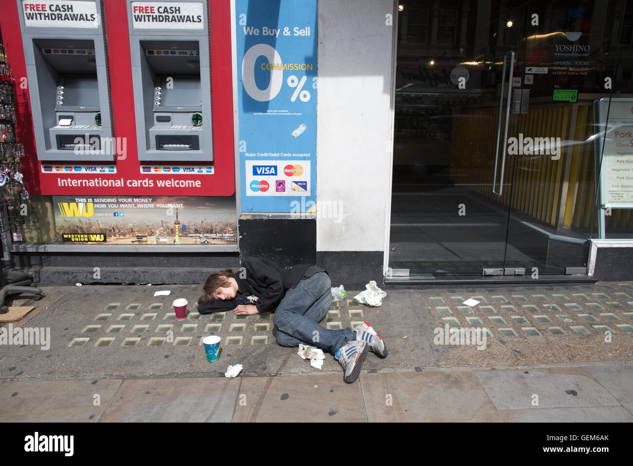 Unconscious drug addict on the streets of London's West End, 28% of men living on streets of London are heroine - Stock Image