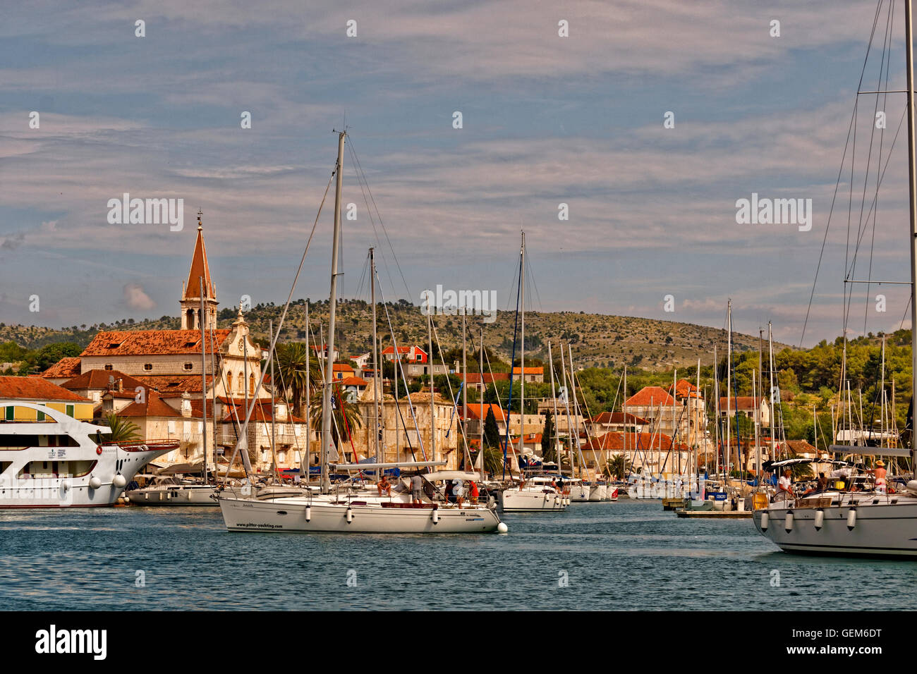 Cruising yacht berthing in the town of Milna on the island of Brac, Croatia. - Stock Image