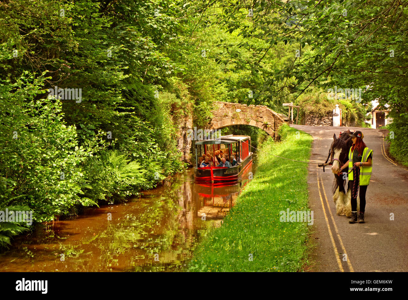Horse drawn tourism barge on the upper Llangollen Canal near the Horseshoe Falls at Llangollen, Denbighshire, Wales - Stock Image