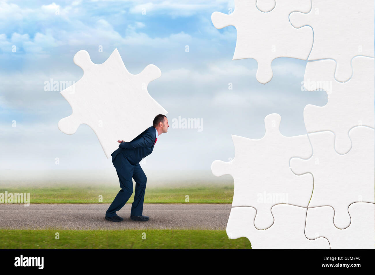 business puzzle concept businessman faces adversity to solve jigsaw - Stock Image