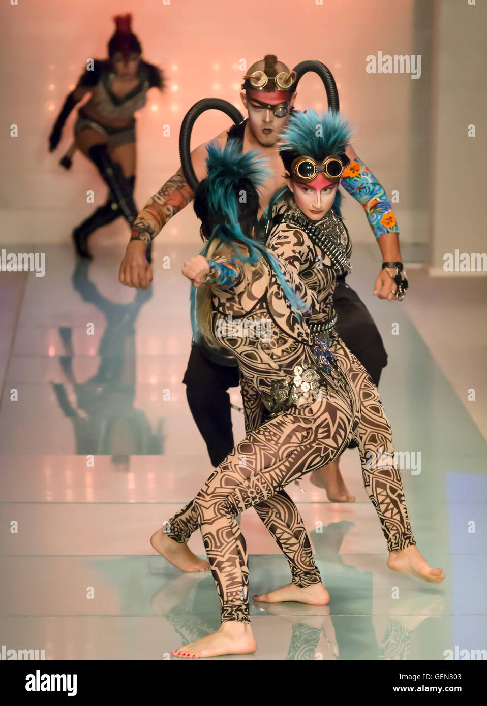 MIAMI BEACH, FL - JULY 16, 2016: Dancers perform at the opening of the runway show for the Luli Fama 2017 Collection - Stock Image