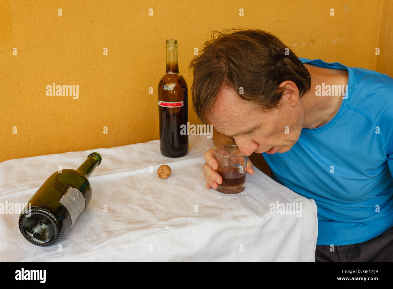 a man swept two bottles of wine - Stock Image