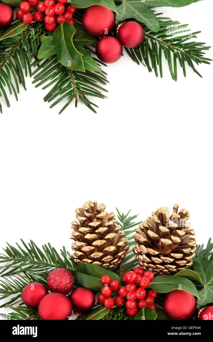 a250f4865106 Christmas background abstract border with red baubles, holly, ivy, gold  pine cones and winter greenery over white.