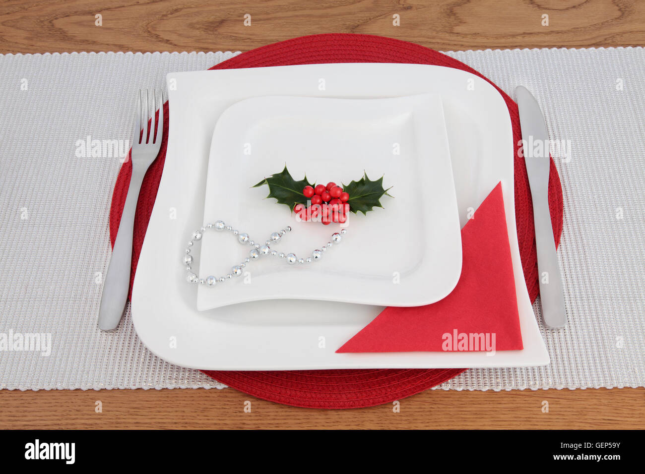Modern christmas table setting with square wave porcelain plates stainless steel cutlery red napkin and silver bead chain. & Modern christmas table setting with square wave porcelain plates ...