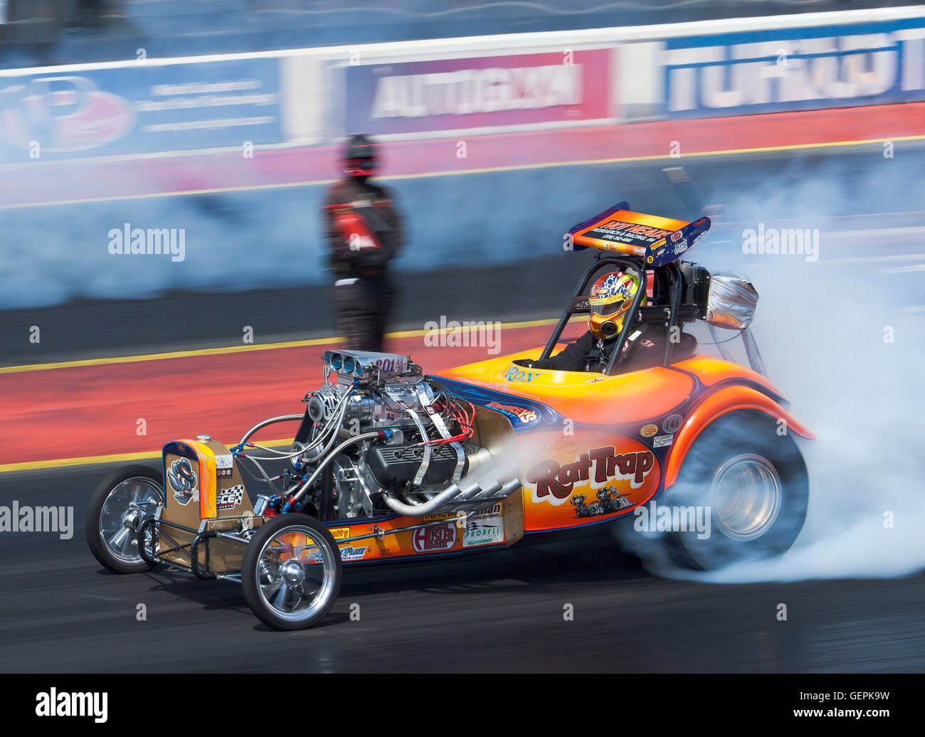 Dragstalgia event at Santa Pod. Ron Hope warming his tyres in his vintage Fuel Altered dragster called Rat Trap. - Stock Image
