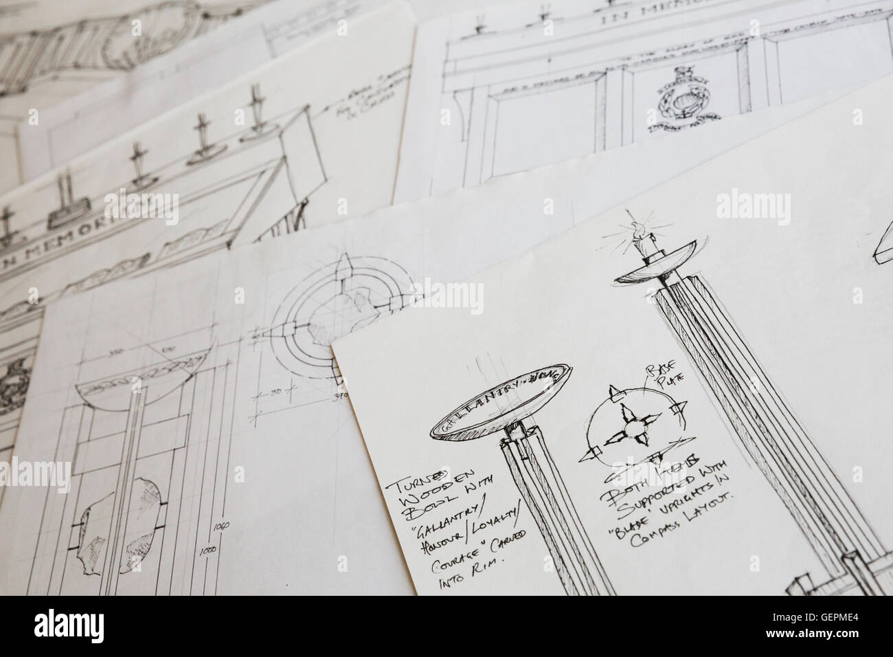 Close Up Of Design Drawings For A Carved Wooden Bowl On A Stand