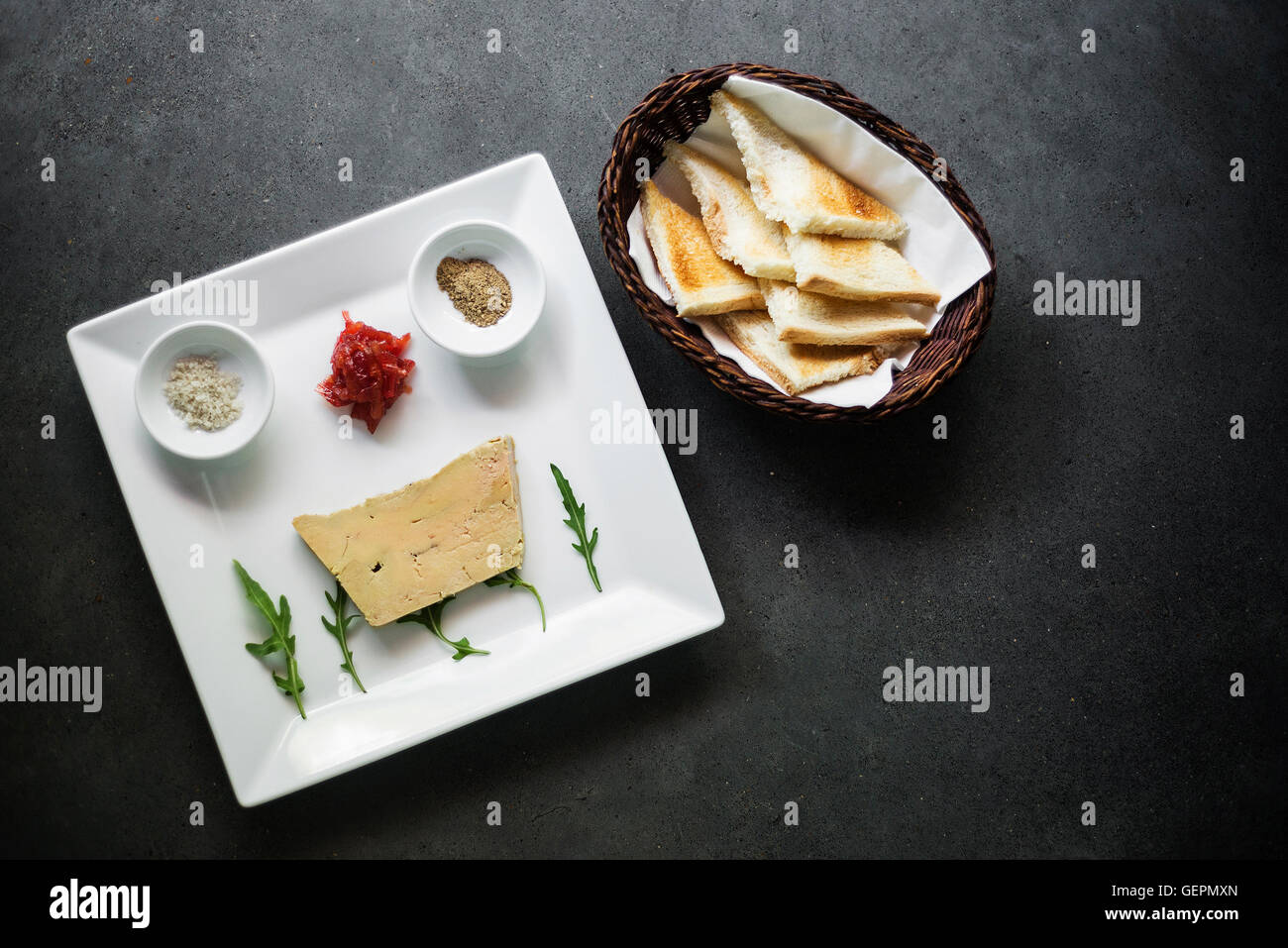 traditional french foie gras duck pate and toast starter snack platter - Stock Image