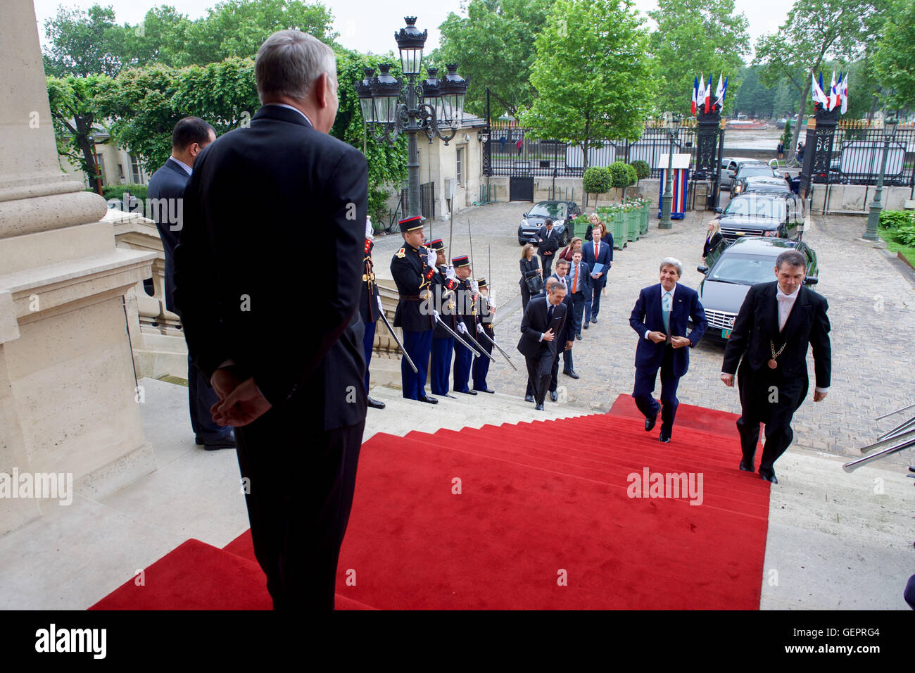 French Foreign Minister Jean-Marc Ayrault Awaits Secretary Kerry as He Arrives at the Quai d'Orsay Stock Photo