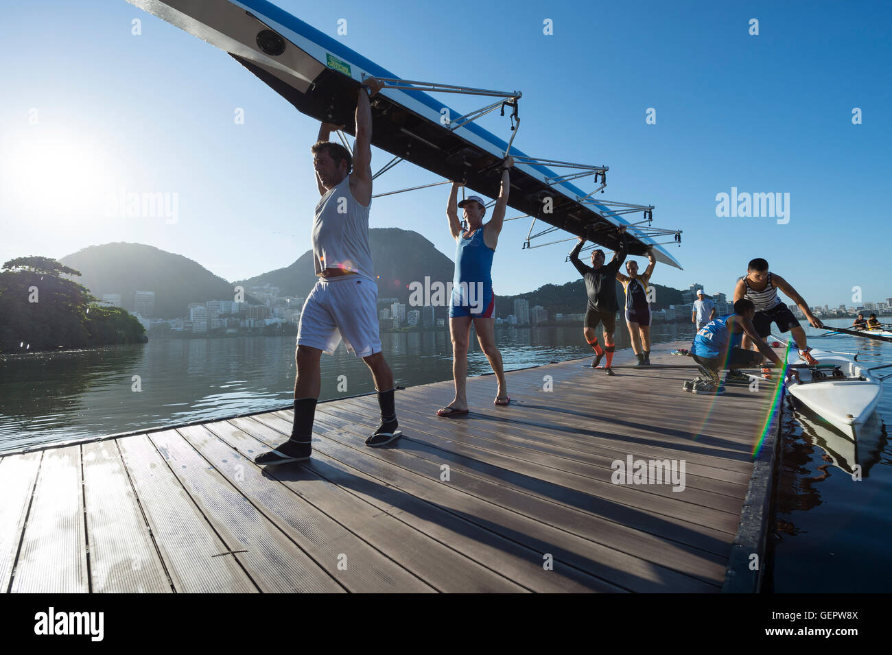 RIO DE JANEIRO - MARCH 22, 2016: After training, Brazilian rowers carry their boat back to the clubhouse at Lagoa. - Stock Image