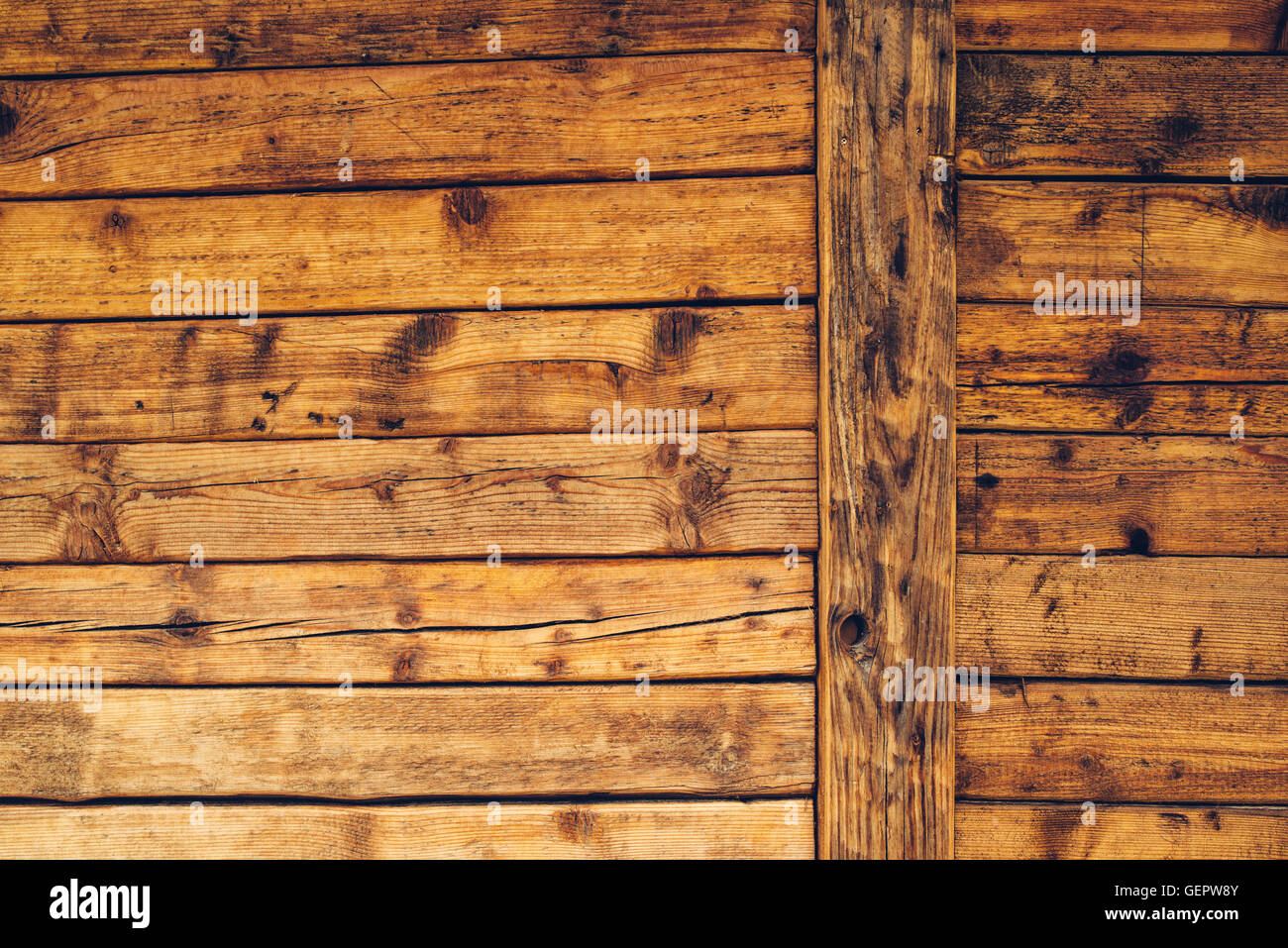 Wooden cabin wall, surface of rustic wood planks - Stock Image
