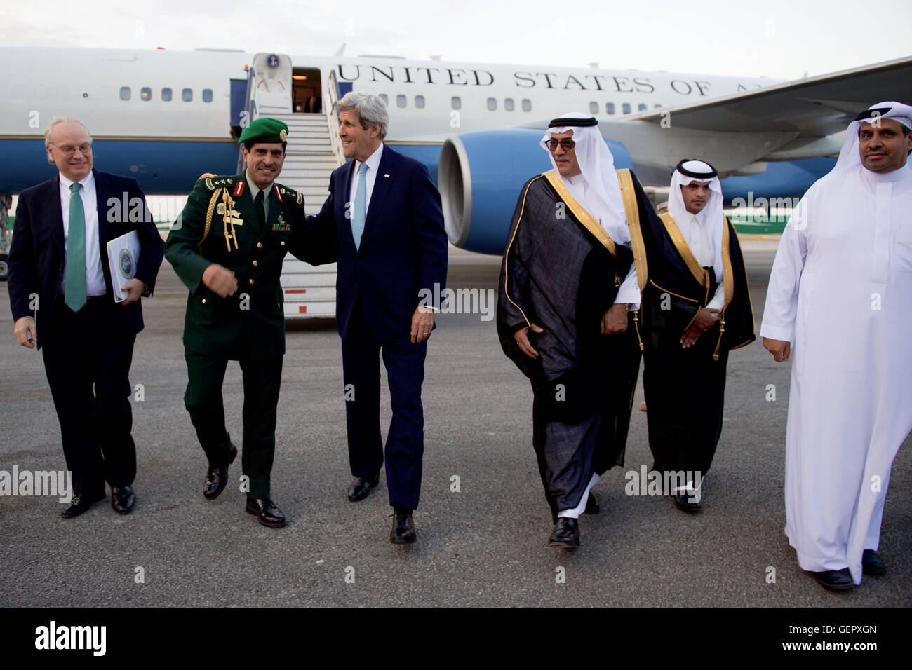 Secretary Kerry Walks With U.S. Embassy Chief of Mission Lenderking and Saudi Officials After Deplaning at King - Stock Image
