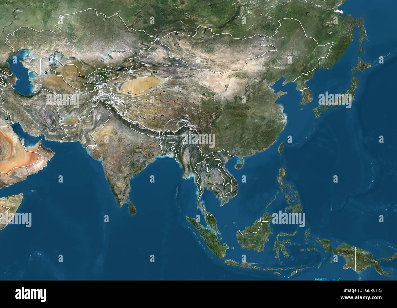 Satellite view of Asia (with country boundaries). This image was compiled from data acquired by Landsat 7 & - Stock Image