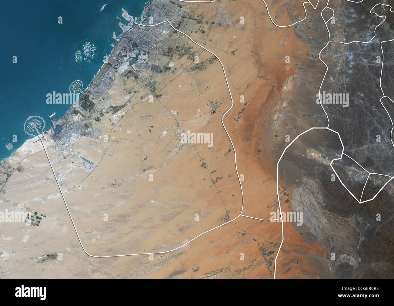 Satellite view of the Emirate of Dubai, United Arab Emirates (with country boundaries). The image shows Palm Jebel - Stock Image