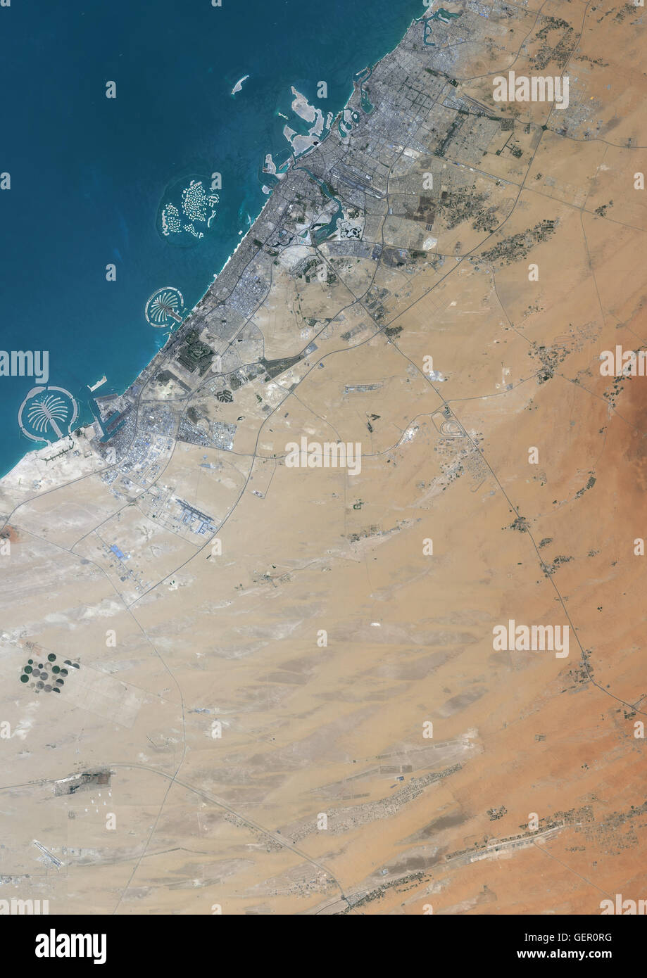 Satellite view of Dubai, United Arab Emirates. The image shows Palm Jebel Ali, Palm Jumeirah and The World Islands. - Stock Image