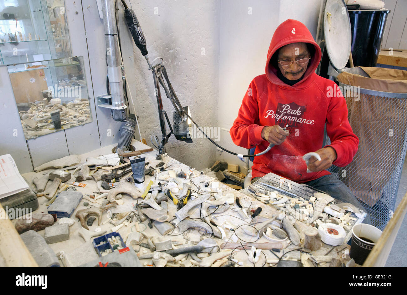 A man making bone carvings at a workshop in Ilulissat, Greenland - Stock Image