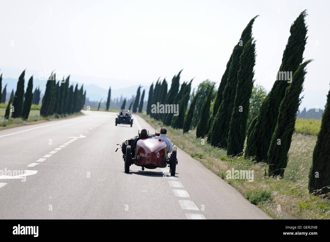 Bugatti speeding down a French road on a windy day during a classic car rally Stock Photo