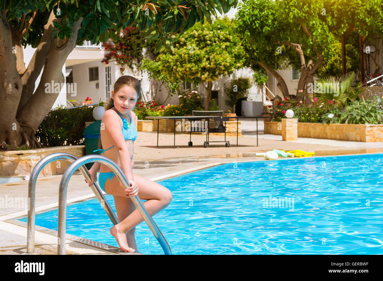 stunning Cute Little Teen Girls Part - 19: Cute little teenage girl in swimsuit standing at pool in middle of day.  Relax and
