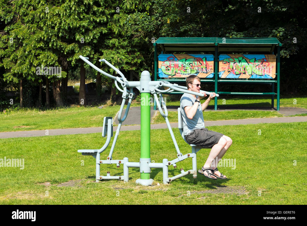 Man Using Outdoor Exercise Equipment In Kingswood Park