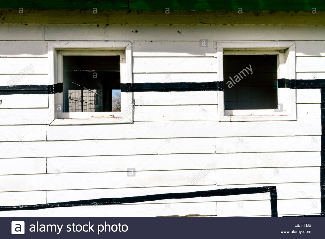 White rustic wood wall with windows - Stock Image