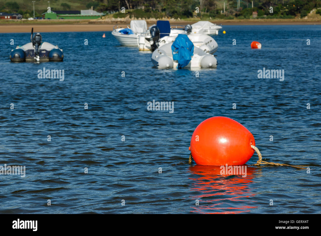 Red buoy on a beach in Cantabria, Spain. Horizontal image. Stock Photo