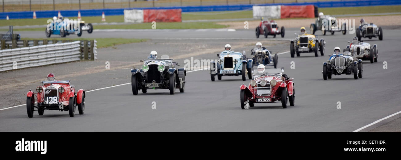 Pre war cars racing with The Vintage Sports Car Club at Silverstone. - Stock Image