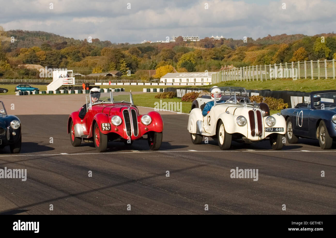 Classic sports cars on the start line at Goodwood with the Vintage Sports Car Club. - Stock Image